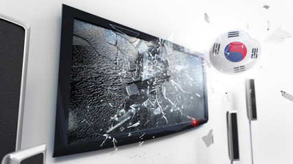 Soccer ball with the flag of South Korea kicked through a shattering tv screen.(3D rendering series)