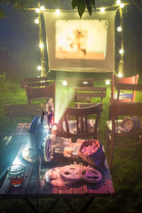 Retro cinema with drinks and popcorn in summer garden