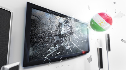 Soccer ball with the flag of Tajikistan kicked through a shattering tv screen.(3D rendering series)