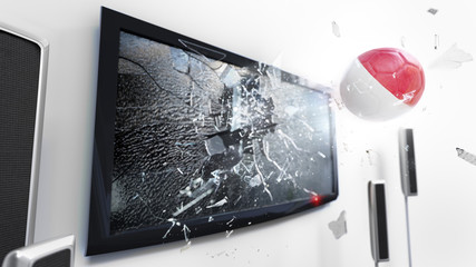 Soccer ball with the flag of Indonesia kicked through a shattering tv screen.(3D rendering series)