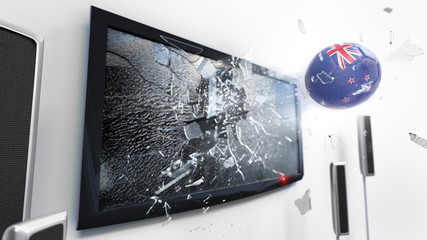 Soccer ball with the flag of New Zealand kicked through a shattering tv screen.(3D rendering series)