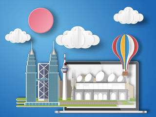 Paper art Malaysia infographic . Malaysia cityscape with labtop .
