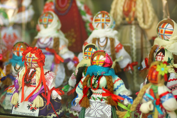 Motankas - traditional ukrainian dolls on display in toy shop window. Symbol of fertility and household guardians,they have no faces to let children develop imagination