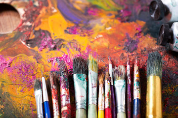 colorful paint brushes on a palette