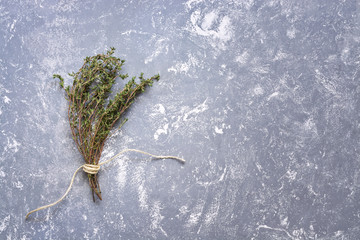 Bouquet of dry herb thyme on a gray background. Top view, copy space.