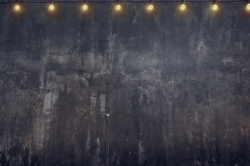 Empty old rustic grunge concrete wall with light bulb string party background,Mock up for display or montage of product or design