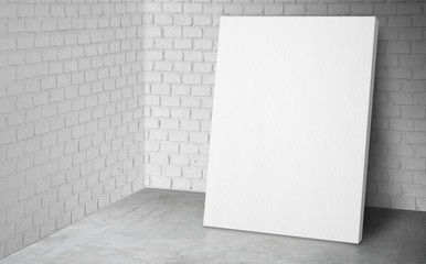 Blank poster at corner studio room with white brick wall and concrete floor background,Mock up studio room for display or montage of product for advertising on media,Business presentation