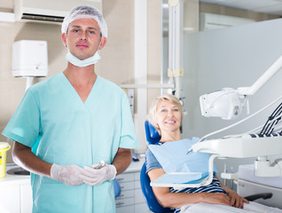 Male dentist standing in dental office