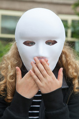 Girl with mask with hands in her mouth