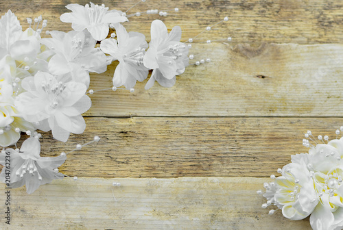 White and ivory silk flowers on a rustic wooden white washed
