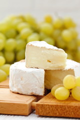 Brie type of cheese and grape. Camembert cheese.