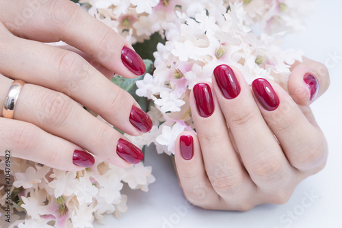 Attractive manicure on women s hands. Natural finger nails with stylish  nail ... 05ddf173c