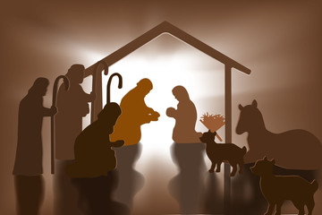 Christian Christmas Nativity Scene of baby Jesus in the manger with Mary and Joseph in silhouette, papers art.