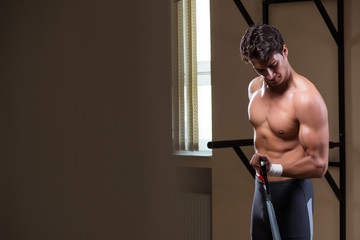 Man working in the gym with springs