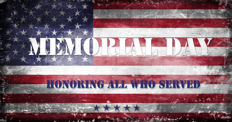 US flag with traces of use in battle and destruction from difficult military operations with Memorial Day inscription in the colors of the national flag and the inscription - We Will Always Remember