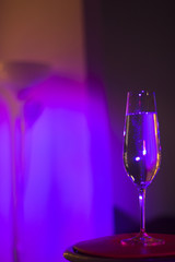 Champagne glass in disco party bar