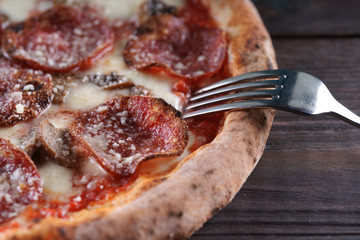 Neapolitan pizza on a wooden table
