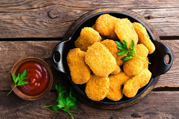 Nuggets. Chicken nuggets with ketchup on wooden table. Fast food Wall mural