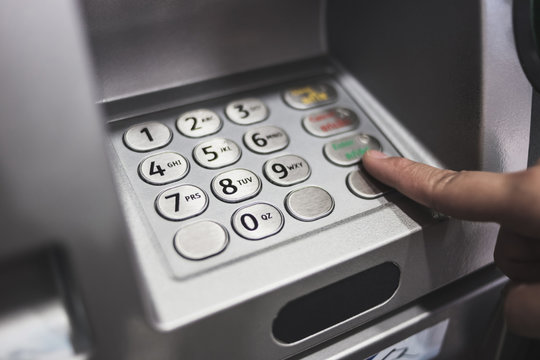 closed up of keypad of atm automatic teller machine