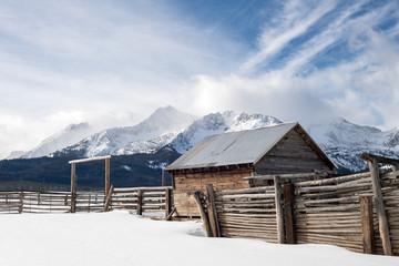 Western corral near Stanley Idaho winter with Sawtooth Mountain range