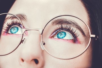 Image of a beautiful young woman wearing glasses. Bright makeup Wall mural