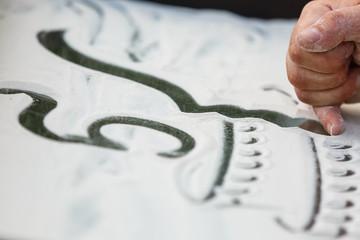 Sand animation. Hands draw sand