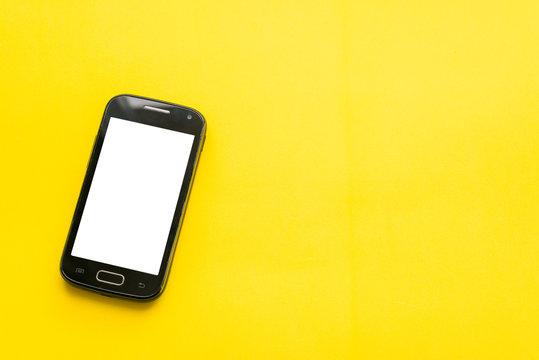 Smartphone on yellow background