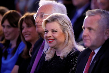 U.S. Deputy Secretary of State John Sullivan, Israeli Prime Minister Benjamin Netanyahu's wife Sara Netanyahu and U.S. Ambassador to Israel David Friedman sit during a reception held at the Israeli Ministry of Foreign Affairs in Jerusalem, ahead of the mov