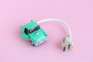 Small retro car with electric cable.