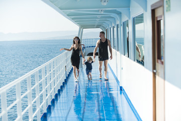 Family ship travel with kid on mothers or fathers day. Mother and father with son in sea trip. Summer vacation of happy family. Child with father and mother. Love and trust as family values.
