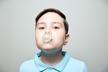kid blowing bubble gum