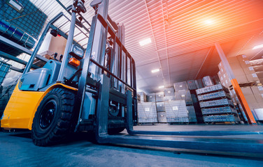 Forklift loader. Pallet stacker truck equipment at warehouse