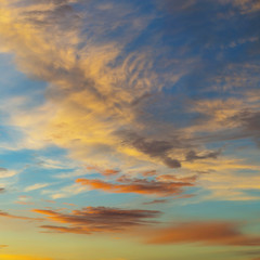 Blue sky and clouds at sunset, background