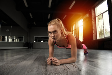 Blonde girl working out at a gym