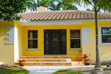 Yellow Florida home with entrance steps