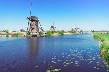 dutch windmill over river waters