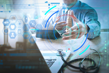 Handshake helping for business Medical technology concept. Doctor hand working with modern digital tablet dock screen computer with medical chart interface, Sun flare effect photo