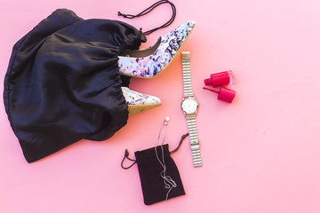 beautiful  pump hight heeled and pink nail polish bottle and white pearl necklace and silver watch