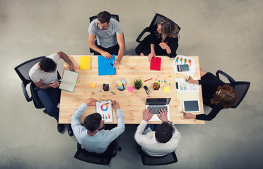 Team of businessmen work together in office. Concept of teamwork and partnership