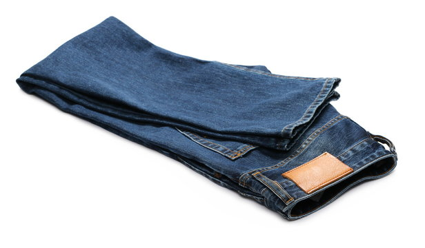 New folded blue jeans isolated on white background
