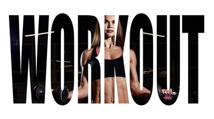 Athlete girl in sportswear working out and training her arms and shoulders with exercise machine in gym. Motivation sign.