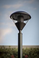 Modern led Street Pole light. Street pole and light fixture against a blue sky background
