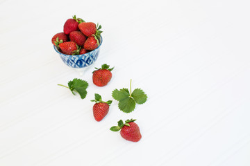 Freshly Picked Strawberries in Blue Bowl on White Tabletop