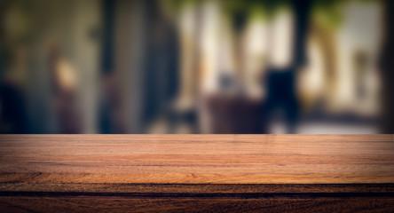 Wooden board empty table blur in coffee shop