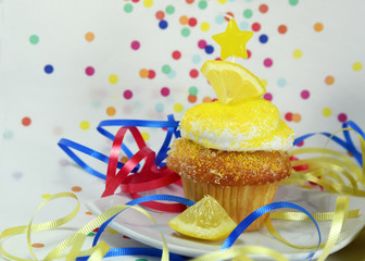 celebration with yellow lemon cupcakes and stars