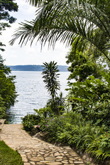 Stone Pathway through the Palm Trees and Garden to Laguna de Apoyo Lake inside an Extinct Volcano Crater in Nicaragua