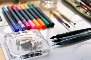 Painter, graphic designer or calligraphy work space, different kind of tools, brushes, marker and pen, place ready to create now design