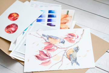 art painting inspiration creativity nature concept. picture of birds. drawing creations. folder full of paintings on paper