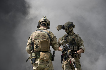 Soldiers with smoke on a wallpaper