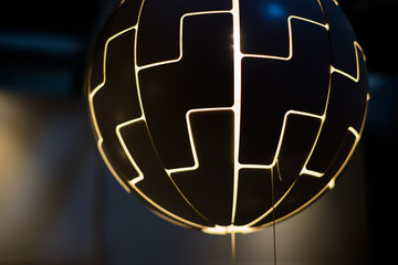Hanging lamp as a ball.The light bulbs are shaped like a large ball hanging from the ceiling. modern rustic decor style. Cosmic style.Light and shadows concept. .